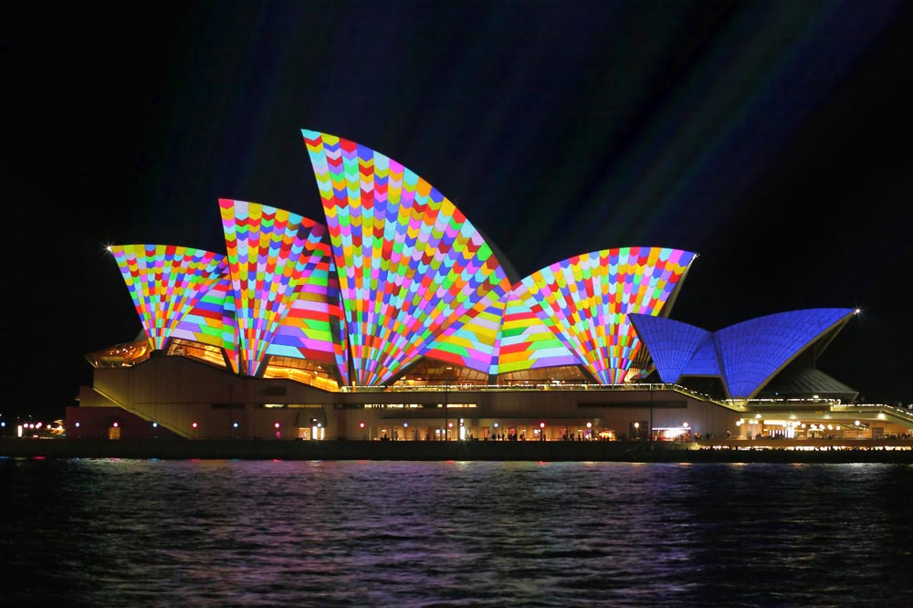SYDNEY, AUSTRALIA - JUNE 2, 2014; Sydney Opera Hosue illuminated in geometric vibrant colour during Vivid Sydney annual festival of light, music and ideas
